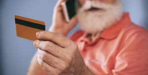 preventing financial abuse dementia man with credit card