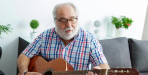 man playing guitar music and dementia