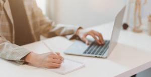 dementia education website working on laptop
