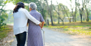 dementia care resource woman walking outside with carer