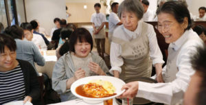 poeple with dementia serve up food