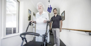 lady with dementia walking with frame adjust temperature settings