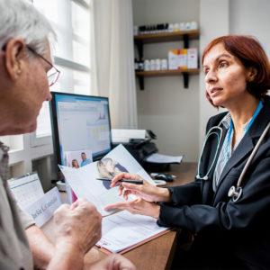 course gp talking to elderly patient