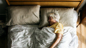 m2 feature night time care woman in bed sleeping