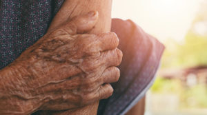 Old woman with muscle pain