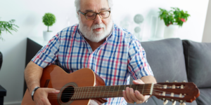 Facilitating-living-old guy playing guitar