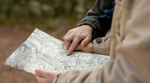 Feature m3 2 people holding a map