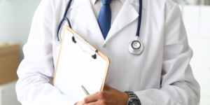 Doctor with clipboard gp management plans