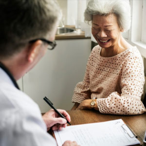 Recognising and diagnosing Dementia gp with elderly lady