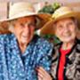 Tailored training 2 elderly women wearing hats