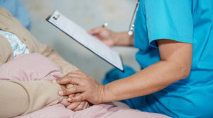 m2 feature doctor talking about diagnosis note clipboard with woman patient hospital