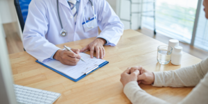 doctor filing out forms diagnosing dementia