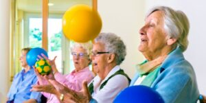 Group of ladies sitting exercise with balls