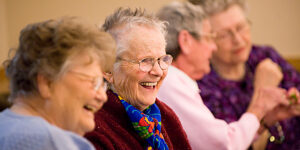 Senior aged ladies talking and laughing together